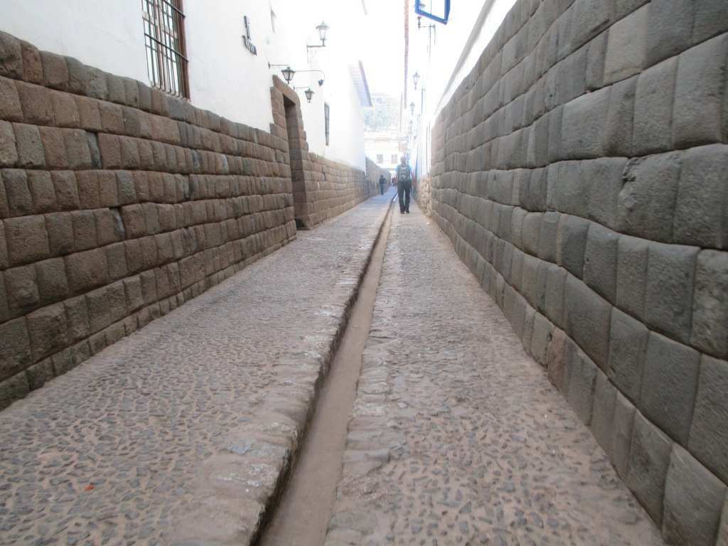 Incan walls made of black basalt serve as foundations for new constructions in Cuzco
